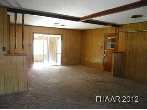 Investor special! Mature home features 2 living areas, full size