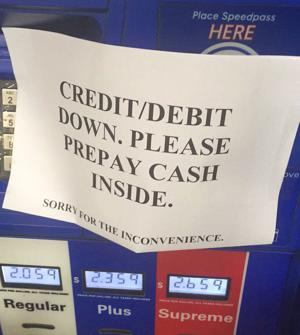 <p>Exxon is one gas-station chain that accepts Apple Pay, unless the credit card machines are down, as happened to writer Omar L. Gallaga. (Handout)</p>