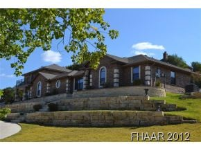 -Custom hilltop home with breathtaking views. Open floorplan, neutral colors