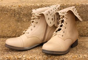 Fashionable Footwear: Studded combat boot in light natural leather by Pink & Pepper, $59.95. - Photo by Steve Pettit | Herald
