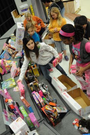 Cavazos Elementary students donate toys to HARP program