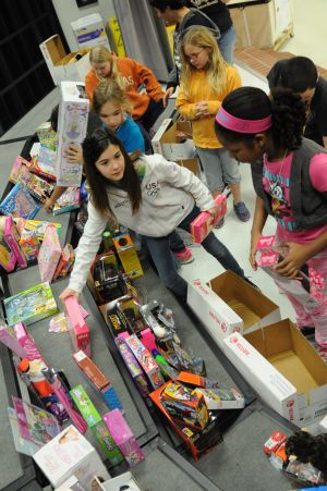 Cavazos Elementary students donate toys to HARP program