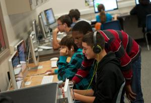 <p>At Smith Middle School at Fort Hood on Dec. 11, seventh-grader Cameron Reese helps classmates use computer coding during an activity called Hour of Code that encouraged students around the world to spend an hour learning computer-coding skills.</p>