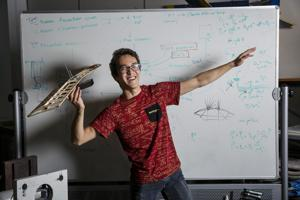 <p>Timothy John, 25, an aerospace engineering senior at UCLA who hopes to go into the defense industry, poses on Jan. 4, 2017 at a Design Build Fly's club lab at UCLA in Los Angeles, Calif. (Marcus Yam/Los Angeles Times/TNS)</p>