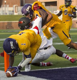 <p>UMHB's Bryce Wilkerson (1) dives into the end zone for a touchdown as teammate T.J. Josey blocks Ohio Wesleyan's Jerry Harper in Belton on Sept. 3.</p>