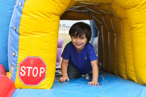 Early Literacy Fair: Nathan Mohammadi (4) plays in the bounce house at the Early Literacy Fair in honor of Children's Book Week held at the Stewart C. Meyer Library on Wednesday morning. - Jodi Perry | Herald