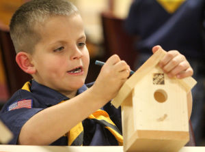 Copperas Cove Boy Scout Christmas Party: Ben Priester, 8, participates in a birdhouse Christmas decoration activity while taking part in the annual Boy Scouts of Leon Valley District Christmas party, Wednesday, December 18, 2013 at Copperas Cove Veterans of Foreign Wars Building. - Photo by Herald/CATRINA RAWSON