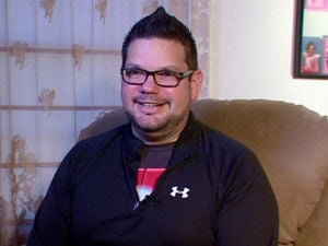 Self-tracking: Tim Davis is seen Oct. 9 in Beaver Falls, Pa. Davis uses several apps and three wearable devices to track his physical activity, vitals and calorie intake. When Davis tipped the scales at 318 pounds two years ago, he bought a Fitbit gadget to track his physical activity and the Lose It! app on his phone to track calories. He bought a Wi-Fi-enabled scale that published his daily weight on his Twitter feed and turned to other apps to track his pulse, blood pressure, daily moods and medications. At one point, Davis said he was using 15 different apps and gadgets, which he said helped him drop 64 pounds by that following year. - AP/Noel Waghorn