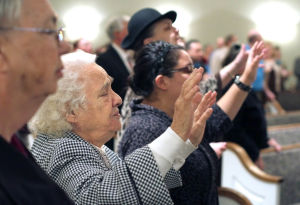 First Church: Worshippers pray during the service Sunday morning at the First Church of Harker Heights. The church recently celebrated its 15th anniversary. - Jaime Villanueva | Herald