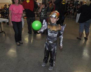 Halloween Party: Nanthaniel Ramirez tosses a ball to win candy at the Kempner VFW 3393's Halloween party on Saturday, Oct. 26. - Photo by Bryan Correira | Herald