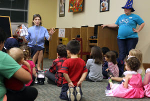 Family Fun Party: Library Director Lisa Youngblood reads a book to children who participated in the Family Fun Party in honor of Children's Book Week, Thursday evening at the Stewart C.Meyer Library in Harker Heights. - Jaime Villanueva | Herald