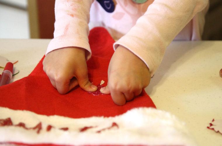 Casa Kids Making Santa Hats