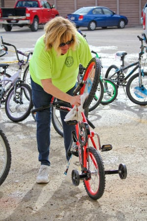 Blue Santa Program: Volunteer Peggy McDonald clean up bikes for the Blue Santa program Saturday, Nov. 16, 2013, in Harker Heights. - Jodi Perry | Herald
