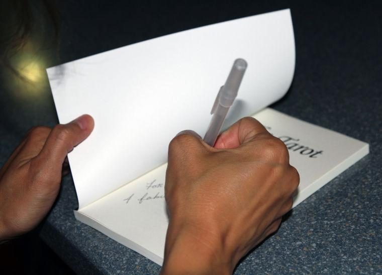 Ellison grad holds book signing