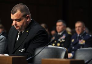 Military Sexual Assaults: Brian Lewis, left, a former sailor in the U.S. Navy, testifies before the Subcommittee on Personnel of the United States Senate Committee on Armed Services about the sexual assault committed against him while in the service, March 13, 2013, in Washington. (Algerina Perna/Baltimore Sun/MCT) - Algerina Perna