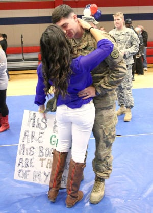III Corps & 3CR Homecoming: Cpl. Brian McPhillips, 3rd Cavalry Regiment, hugs his wife Alicia McPhillips during the III Corps and 3rd Cavalry Regiment Homecoming Sunday night at West Fort Hood. - Photo by Herald/MARIANNE GISH