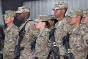 15th Finance Battalion Deployment: Soldiers in the 15th Finance Battalion, 13th Financial Management Center stand at attention during their deployment ceremony, Wednesday, September 25, 2013 at Fort Hood. - Herald/CATRINA RAWSON