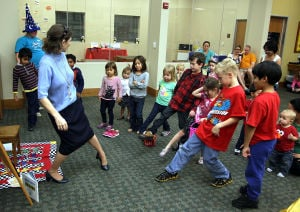 Family Fun Party: Library Director Lisa Youngblood dances with children who participated in the Family Fun Party in honor of Children's Book Week, Thursday evening at the Stewart C.Meyer Library in Harker Heights. - Jaime Villanueva | Herald