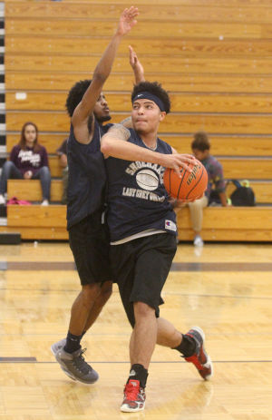 Shoemaker Boys Basketball Seniors: Seniors' Patrick Mark, left, attempts to block Shane Johnson, right, from making a shot during practice Thursday afternoon at Shoemaker High School. - Herald/MARIANNE GISH