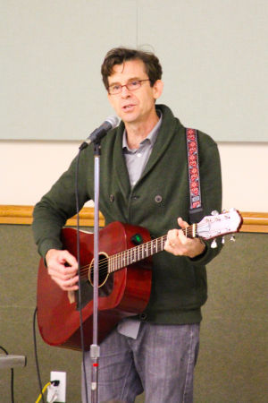 Early Literacy Fair: Joe McDermott sings during the Early Literacy Fair held at the Stewart C. Meyer Library on November 20th. - Jodi Perry | Herald