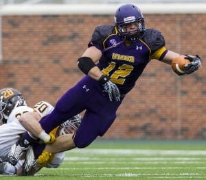 UMHB FOOTBALL NOTEBOOK: UMHB running back Elijah Hudson stretches for extra yardage as Rowan's John Dokouslis makes an ankle tackle Saturday at Crusader Stadium in Belton. - Michael Miller | FME News Service