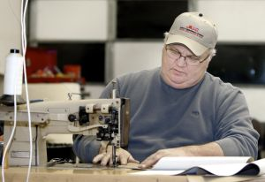 FURNITURE REPAIR: John Nordine stitches upholstery at his furniture repair shop in Grand Forks, N.D. - John Stennes |Grand Forks Herald