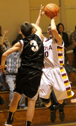 Lometa Vs Evant Boys Basketball: Lometa's Justus Alaniz shoots against Evant on Tuesday in Lometa. - Herald/CATRINA RAWSON