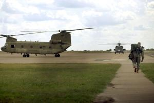 <p>Col. Jeffery B. Thompson prepares to fly the UH-60 Blackhawk during his last flight as the 1st Air Cavalry Brigade's commander at the Hood Army Airfield Monday, July 25, 2016.</p>