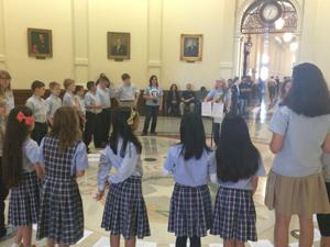 Choir sings at Capitol