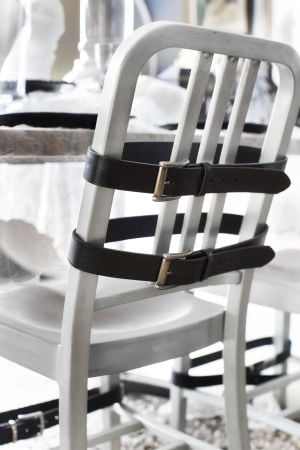 Homes-Designer-Halloween Parties: Turn chairs into straitjackets using black leather belts to add impact for Halloween parties. - Photo by Scripps Networks Interactive