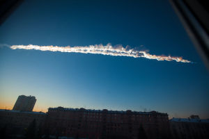 Asteroid Hit: A meteorite contrail over the Ural Mountains' city of Chelyabinsk, about 930 miles east of Moscow is seen Feb. 15, 2013. After a surprise meteor hit Earth at 42,000 mph and exploded over a Russian city in February, smashing windows and causing minor injuries, scientists studying the aftermath say the threat of space rocks hurtling toward our planet is bigger than they had thought. - Yekaterina Pustynnikova | Chelyabinsk.ru