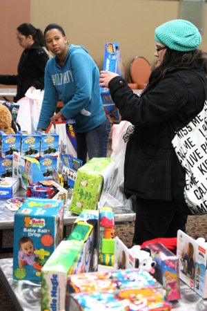 Operation Homefront Toy Distribution: Participants pick out toys for the Operation Homefront's toy distribution for families event Tuesday morning at the Fort Hood Community Event and Bingo Center on Fort Hood. - Photo by Herald/MARIANNE GISH