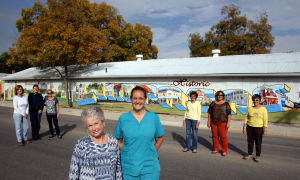 Lampasas Murals: From left, Libby Bluntzer, Shirley Blake, Katherine Mezger, Joann Davidson, Barbara Adams, Sharon Pinkney, Dianna Hodges, president of Vision Lampasas and Nancee Stevens in front of the