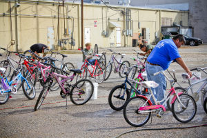 Blue Santa Program: Volunteers clean up bikes for the Blue Santa program Saturday, Nov. 16, 2013, in Harker Heights. - Jodi Perry | Herald