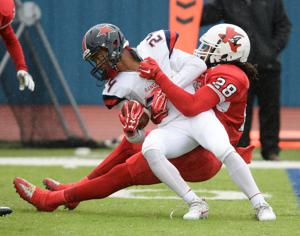 <p>Trinity Valley's Jaquay Pough stops Northwest Mississippi's Jamario Dixon for a loss in the 16th annual Heart of Texas Bowl at Bulldawg Stadium in Copperas Cove. Trinity Valley won 34-24.</p>