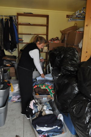 Make A Difference Day: Tracy Carney, the assistant director for Option House Youth Shelter, sorts through clothes Saturday at the Killeen shelter.