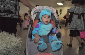 Halloween Party: Jay Crawford, 1, sits in his stroller dressed in his Monster's costume. - Photo by Bryan Correira | Herald