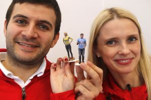 Sochi Airport Uses Silicon Valley Facial Recognition Software: Alexander Merkviladze, left, and Anna Galdina hold up figurines of themselves produced using the company's technology at Artec Group on Monday in Palo Alto, Calif. The company created facial recognition software that Sochi officials are using to improve airport security during the Winter Olympics. - Jim Gensheimer | Bay Area News Group
