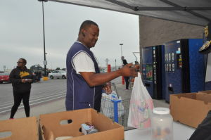 Make A Difference Day: Jaron Cathcart of Killeen takes part in a food drive Saturday at the Walmart store in Copperas Cove. The drive collected donations for My Brother's House Food Bank and the Copperas Cove Soup Kitchen. - Photo by Bryan Correira | Herald