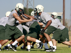 Ellison football players run drills