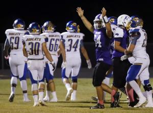 <p>Florence's Cutter Callan (54) celebrates after Florence scored a touchdown against Comfort on Friday at Florence High School.</p>