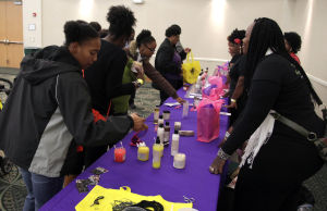 Natural Hair.Photo J.Villanueva 0004.jpg: Shoppers pick skin care lotion during the third Armed Forces Natural Hair and Health Expo Saturday afternoon at the Killeen Civic & Conference Center. - Jaime Villanueva