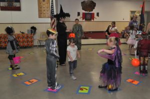 Halloween Party: Volunteers and children play games at the Kempner VFW 3393 Halloween party. - Photo by Bryan Correira | Herald