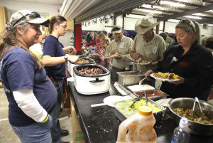 Oakalla VFD Dinner, Auction: Attendants go through the line during the all-you-can-eat fajita dinner and auction Saturday evening at the Oakalla Volunteer Fire Station. - Jaime Villanueva | Herald