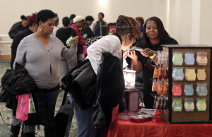 Natural Hair.Photo J.Villanueva 0003.jpg: Visitors buy soap during the 3rd Armed Forces Natural Hair and Health Expo Saturday afternoon at the Killeen Civic & Conference Center. - Jaime Villanueva