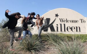 Seek Irony: Kfir Gov, Alex Campbell, Rom Gov and Daniel Strosberg, members of the band Seek Irony, are seen Tuesday, Nov. 12, 2013, at the Welcome to Killeen sign. The modern rock group is originally from Israel and recently relocated to Austin. - Photo by Herald/CATRINA RAWSON