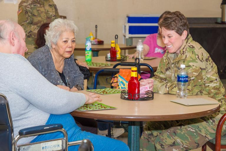 Fort Hood warrant officers bring joy to Heights seniors
