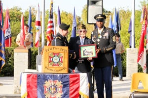 VFW Veterans Day: The 720th Military Police Battalion presents a plaque to the Veterans of Foreign Wars Post 3892 during the Veterans Day Ceremony on Monday, Nov. 11, 2013. - Photo by Jodi Perry | Herald