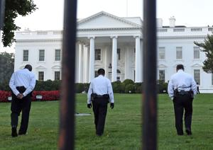 <p>Uniformed Secret Service officers walk along the lawn on the North side of the White House in Washington, Saturday, Sept. 20, 2014. The Secret Service is coming under renewed scrutiny after a man scaled the White House fence and made it all the way through the front door before he was apprehended. (AP Photo/Susan Walsh)</p>