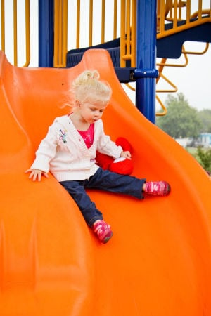 Goode-Connell Park: Nadine Henning, 2, tests out the slide at the Goode-Connell Park on Monday, Oct. 28, 2013, in Harker Heights. - Jodi Perry | Herald